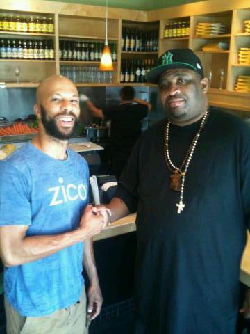 Patrice with Rapper Common. Health food spot in LA.